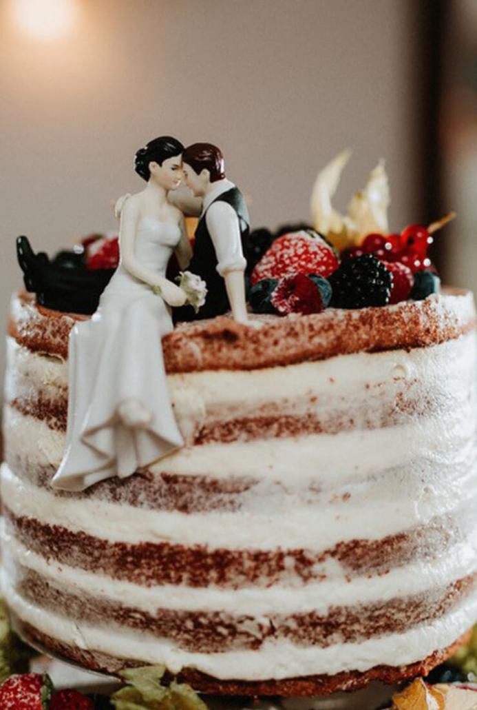 Der Anschnitt der Hochzeitstorte